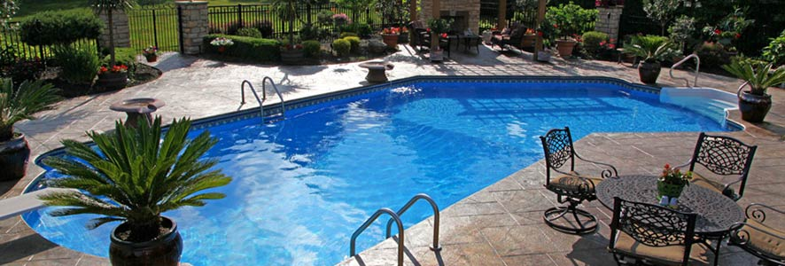 L-Shaped Pool with Patio Furniture